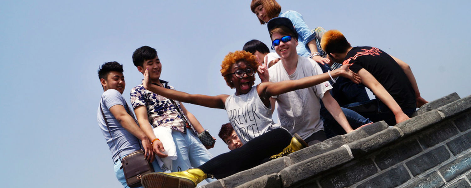 Kent State economics major and Chinese minor Garmai Matthew sits at one of the highest points of the Great Wall of China with her Kent State classmate Jonathan Warner and other tourists.