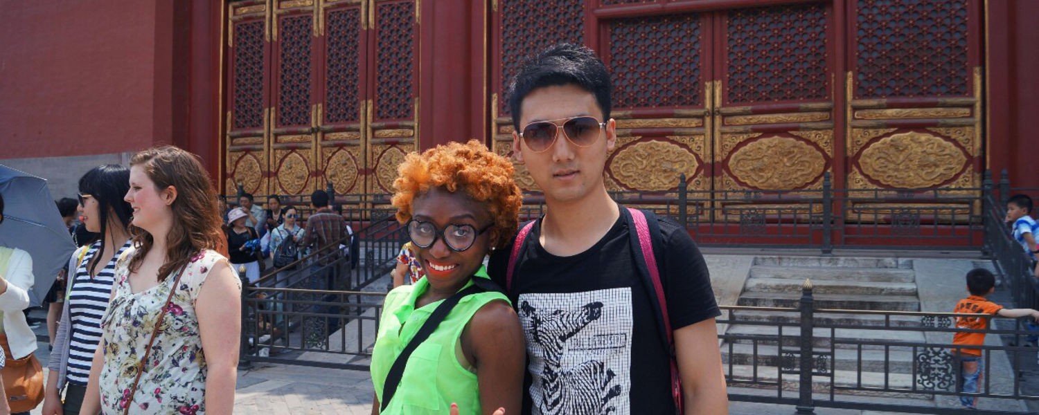Kent State economics major and Chinese minor Garmai Matthew poses with a tourist friend inside the Forbidden City during her education-abroad trip to China.