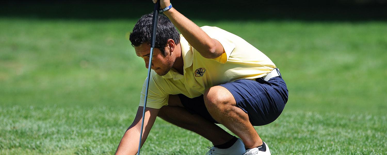 Kent State golfer Nick Scott lines up a putt during the 2013 season.