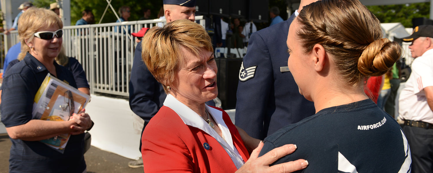 Kent State President Beverly Warren greets a recent Kent State graduate who was sworn into the U.S. Air Force during a military ceremony at the World Golf Championships-Bridgestone Invitational.