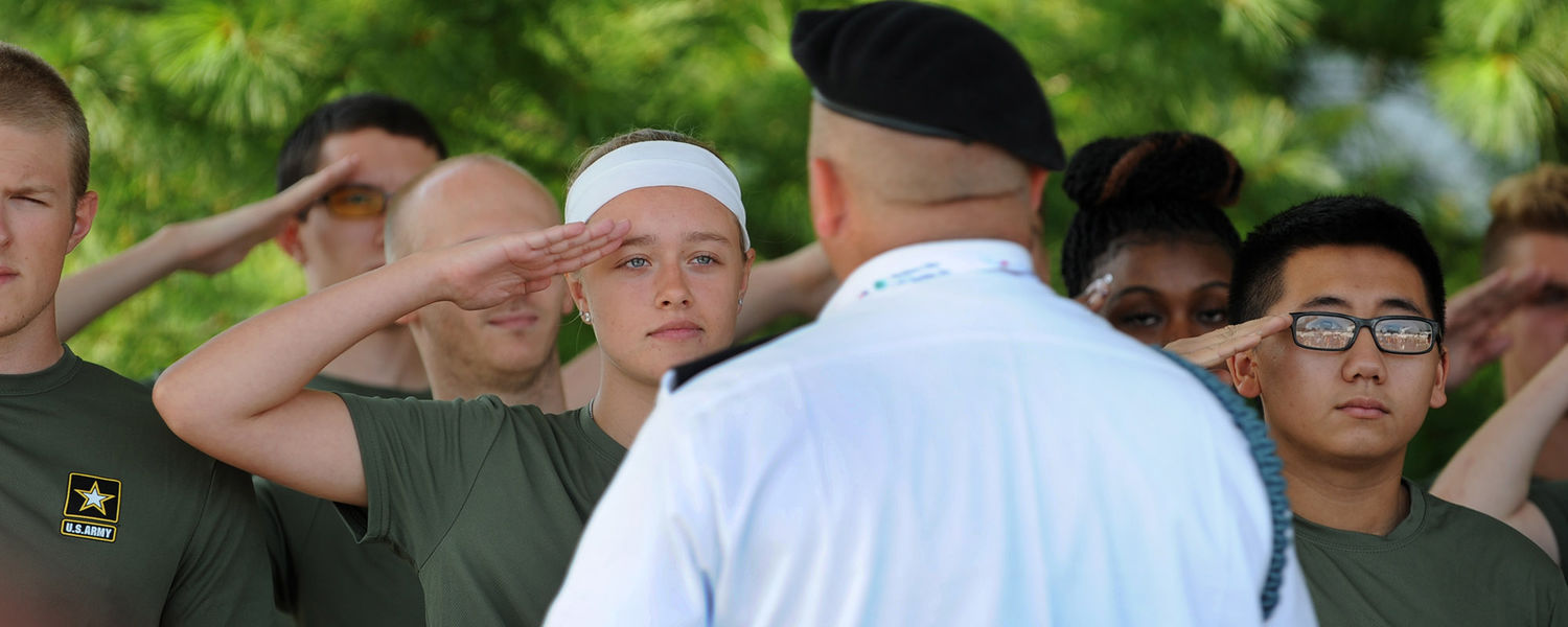 New U.S. Army recruits practice saluting prior to being sworn in during the military ceremony at the World Golf Championships-Bridgestone Invitational.