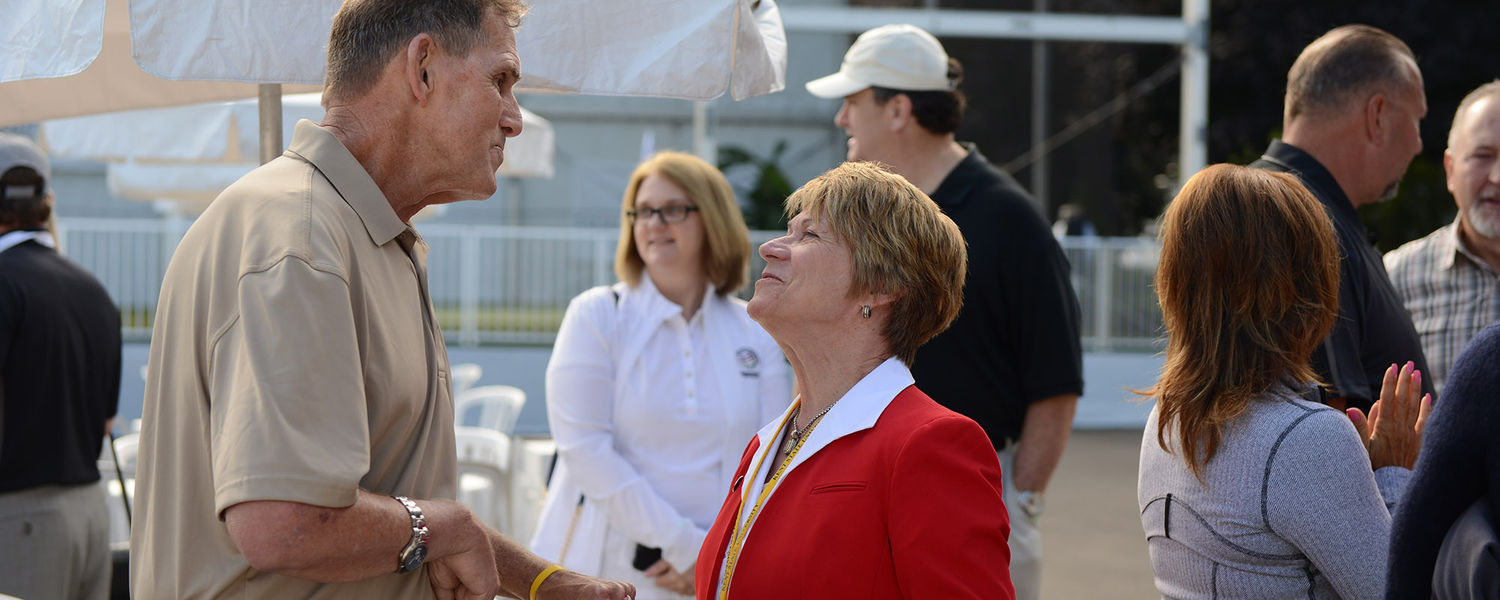 Kent State President Beverly Warren greets a disabled veteran during a military ceremony at the World Golf Championships-Bridgestone Invitational.