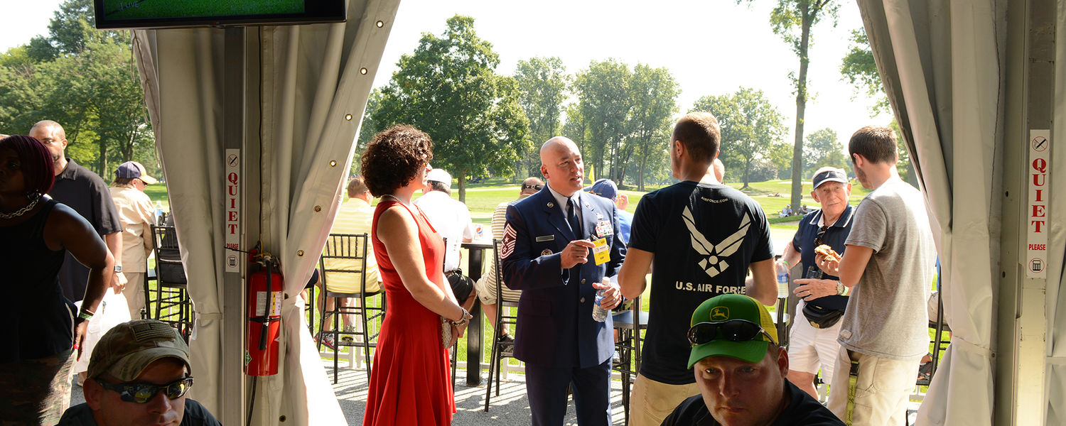 Military families and veterans enjoy shade and refreshments at the Patriots' Outpost tent at the World Golf Championships-Bridgestone Invitational as a part of the Birdies for the Brave, a national military outreach initiative supported by the PGA TOUR.