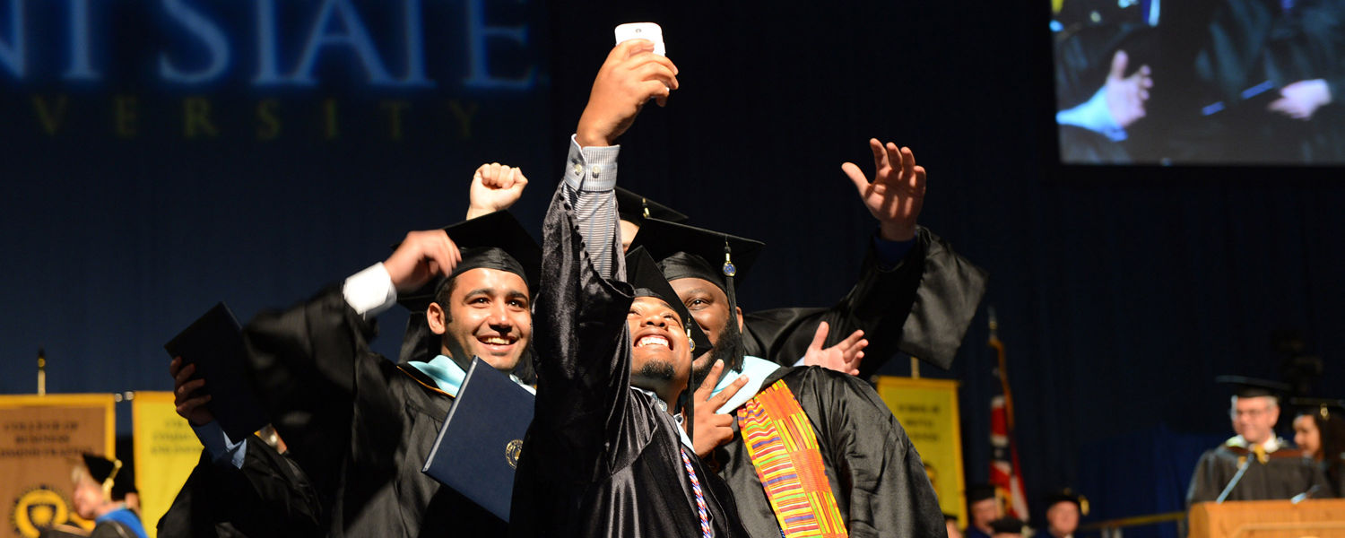 A group of Kent State graduates take a photo of themselves during their Commencement ceremony on May 8.