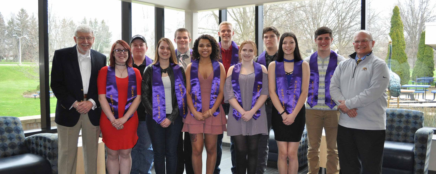 Dr. Charles K. Leedy (far left) and Dr. David Dees (far right) stand with the first class of graduates from the Kent State Columbiana County Rural Scholars Program. The graduates include (front, from left) Morgan Briand, Calie Sherrill, Lanay Brentley, Er