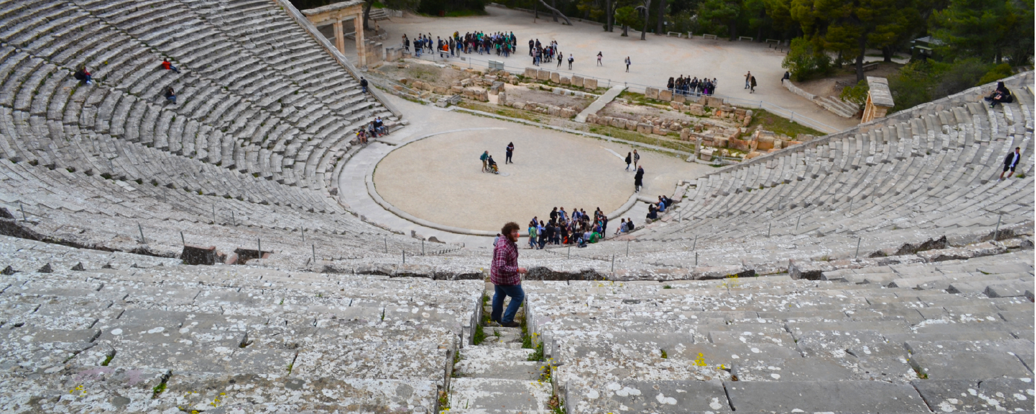 Jake Glosser tests the sound at Epidaurus, renowned for its exceptional acoustics