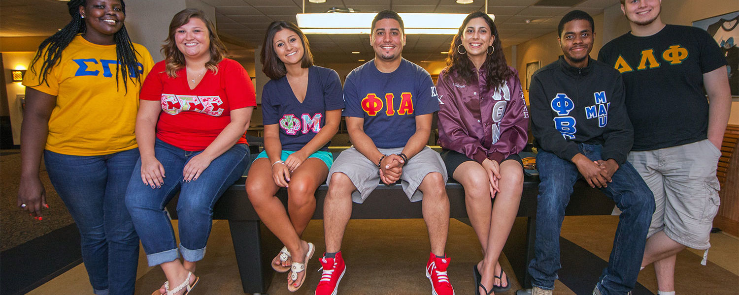 A group of students from all three councils of Kent State's Fraternity and Sorority Life pose for a picture. (Photo credit: Signum Design)