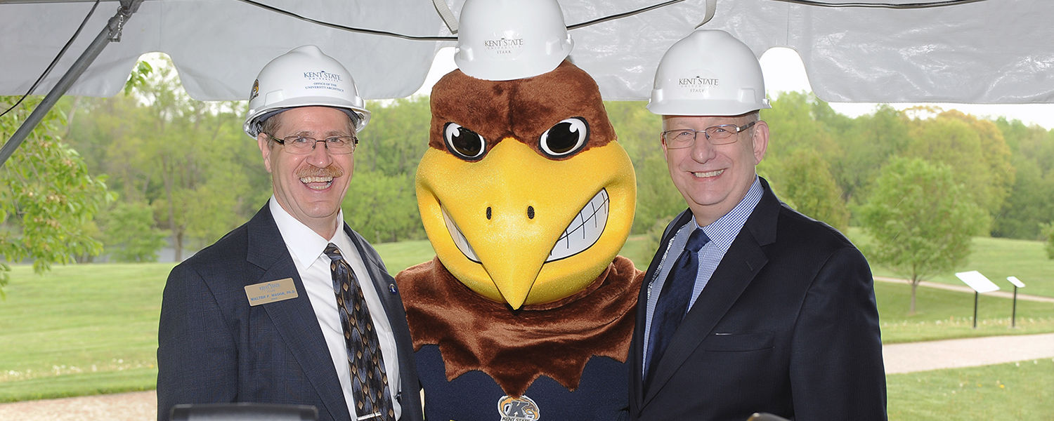 Kent State University at Stark Dean Walter F. Wagor (left) poses for photos with Kent State's mascot, Flash, and Kent State University President Lester A. Lefton during the groundbreaking ceremony for the new Sciences Building at Kent State Stark.