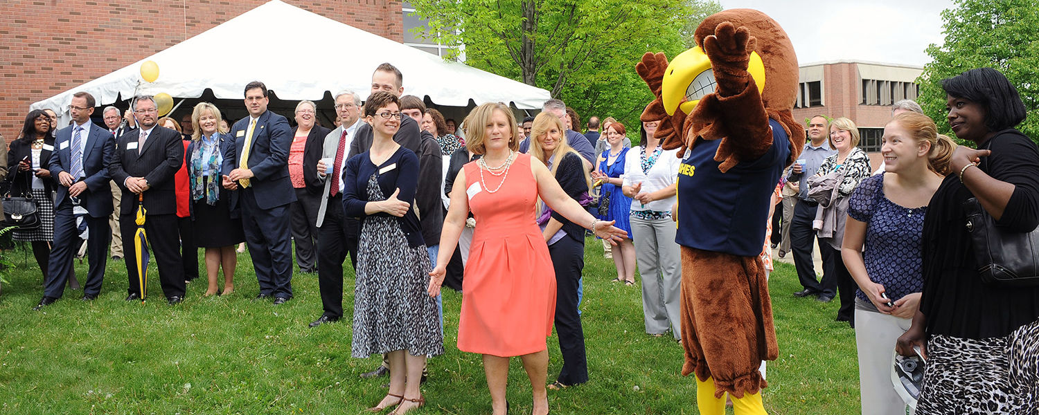 Guests attending the Sciences Building groundbreaking ceremony at Kent State University at Stark recognize an appearance by Flash, the official Kent State mascot, during the event.