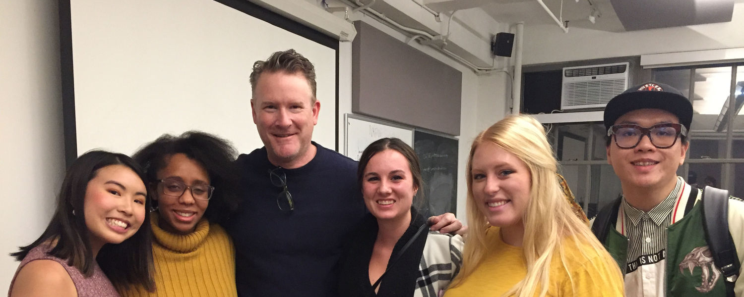 NYC Studio students posing for a picture with guest lecturer Todd Snyder