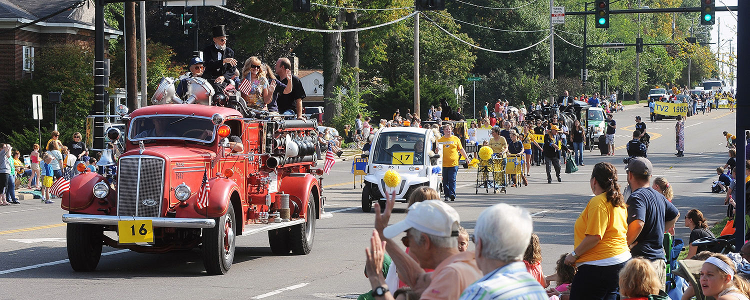 The 2013 Homecoming parade makes its way down Main Street.