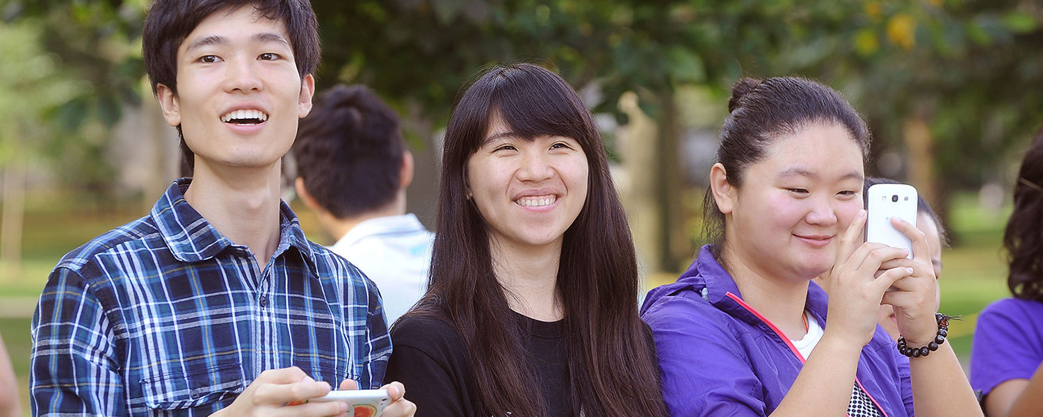 International students enjoy last year's Homecoming festivities near Williamson   Alumni Center.