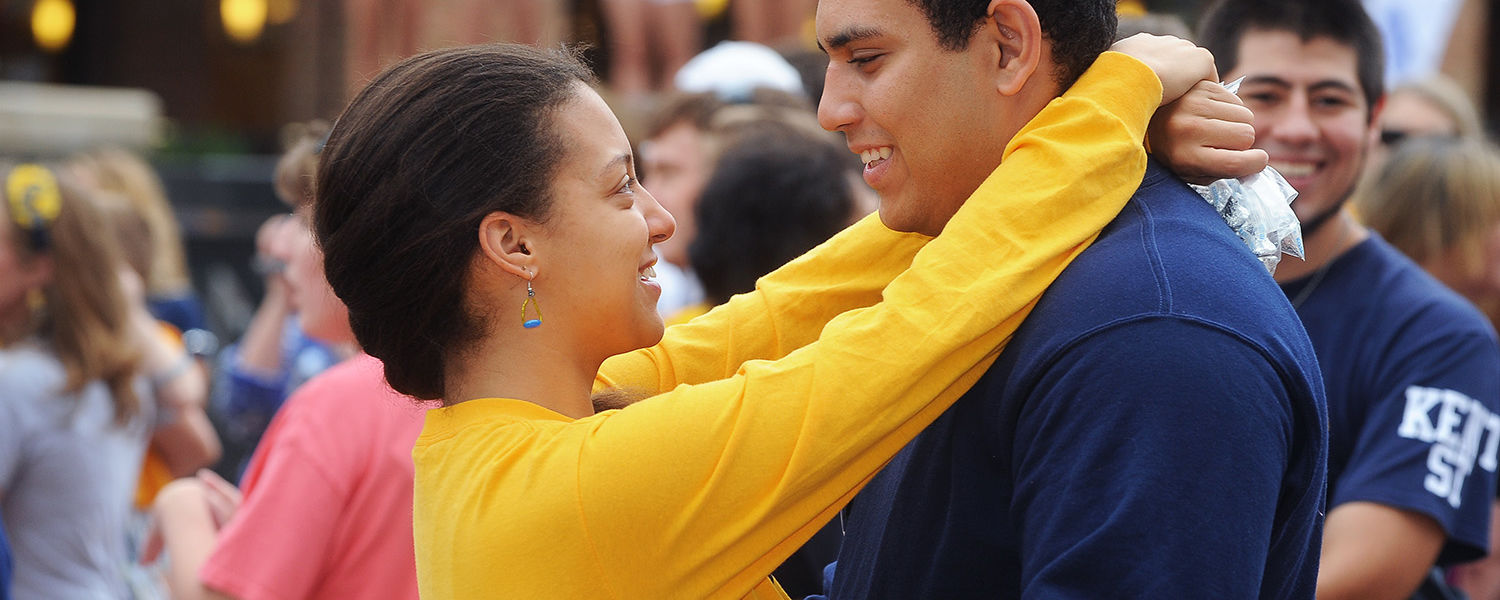 Kent State students participate in the annual Kiss on the K on Risman Plaza during  last year's Homecoming.