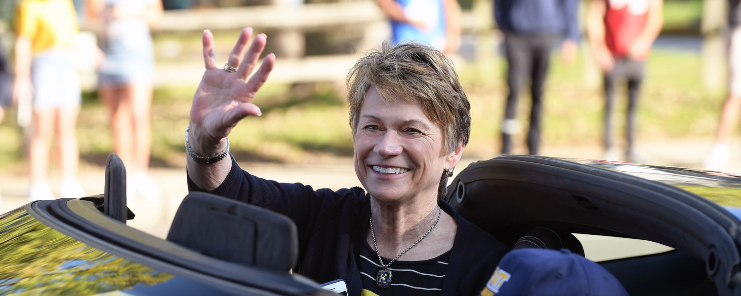 Kent State President Beverly Warren waves to students, alumni and Kent residents as she rides along the parade route during the 2017 Homecoming Parade.