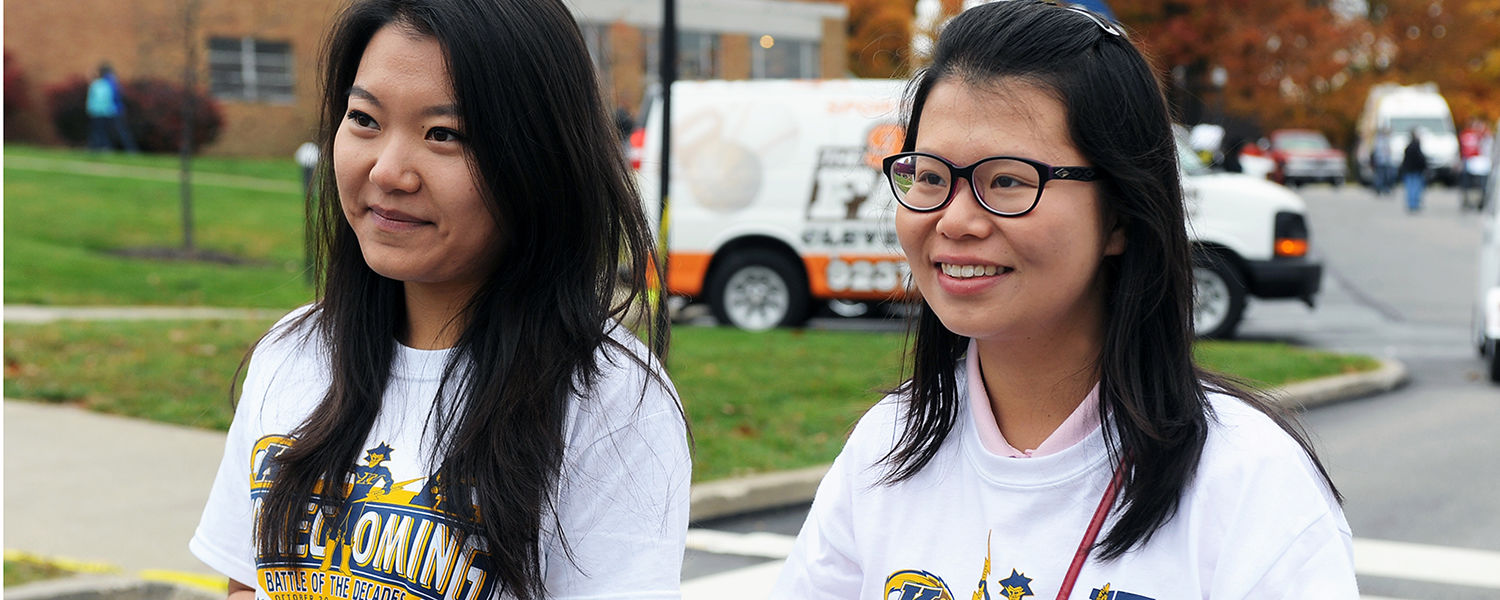 Kent State international students brave the rain and cold of the 2012 Homecoming to view the Homecoming parade.