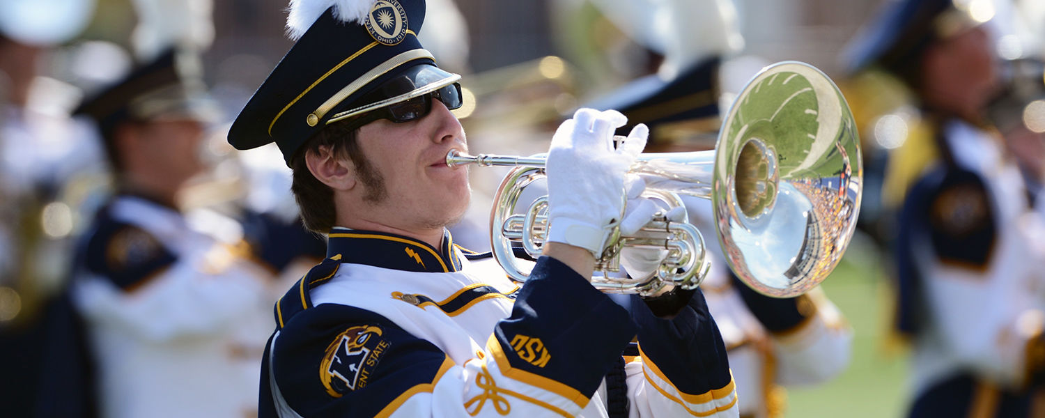 The Kent State University Marching Band performs on the field at Dix Stadium.