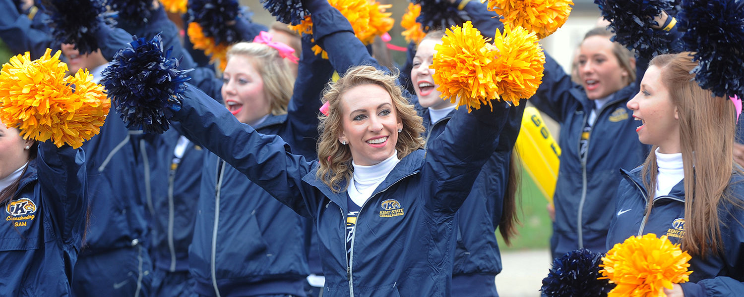 The Kent State cheerleading squad makes its way down Main Street as part of the Homecoming parade.