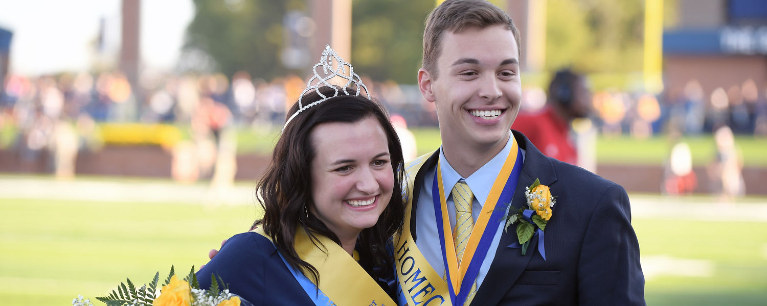 Homecoming King Bruno Beidacki and Queen Marisa Stephens celebrate their 2017 win during the halftime ceremony at the football game.