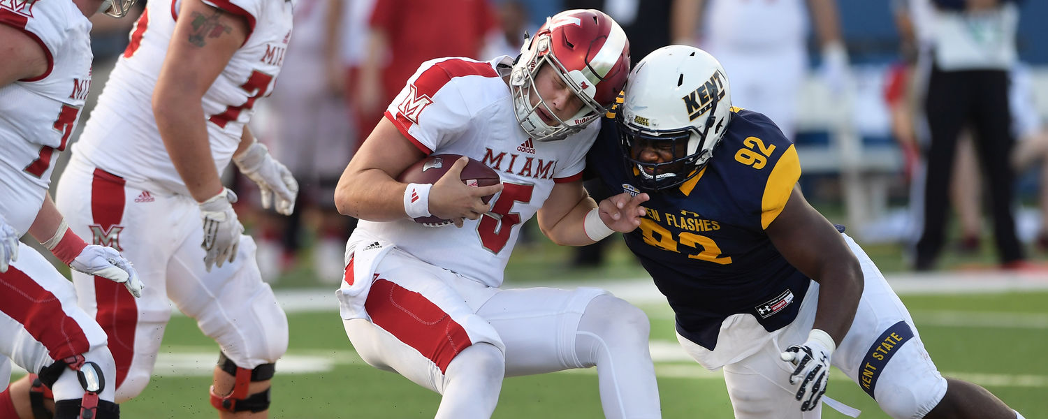 Kent State defensive lineman Theo Majette breaks through the Miami defense to record a fourth quarter sack during Kent State's win over the RedHawks at Dix Stadium.
