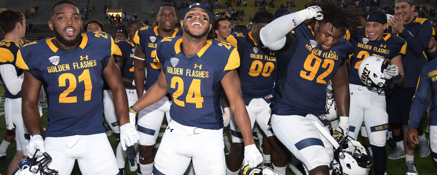 Kent State football players take to the field to celebrate their 17-14 win over the visiting Miami RedHawks during the Homecoming game at Dix Stadium.
