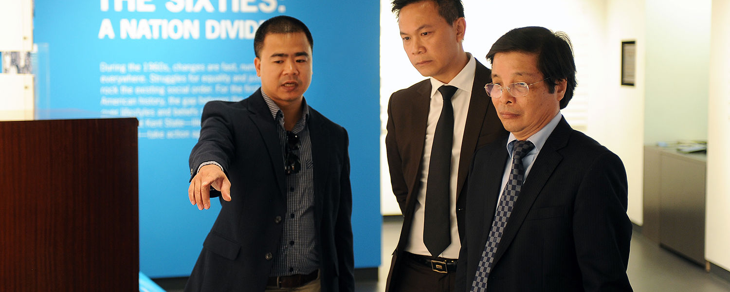 (left to right) Hanoi University's Dr. Hoang Gia Thu, dean of faculty of management and tourism, Nguyen   Ngoc Tan, director of the international office, and Nguyen Dinh Luan, president, tour the May 4 Visitors Center in Taylor Hall.
