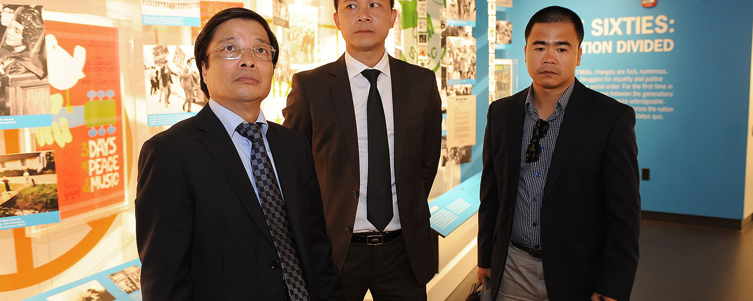 Hanoi University President Nguyen Dinh Luan (left) tours the May 4 Visitors Center with Nguyen Ngoc   Tan (center), director of the international office, and Dr. Hoang Gia Thu (right), dean of faculty of management and tourism at Hanoi University.