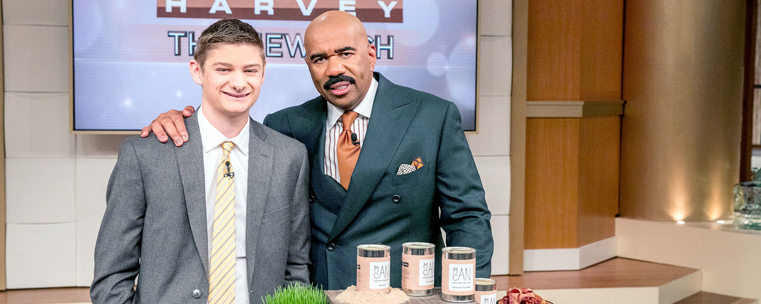 """Kent State student Hart Main appeared on """"Steve Harvey"""" to showcase his ManCans, masculine-scented candles that he makes and sells with a philanthropic twist. (Photo credit: Jeff Schear/NBC)"""