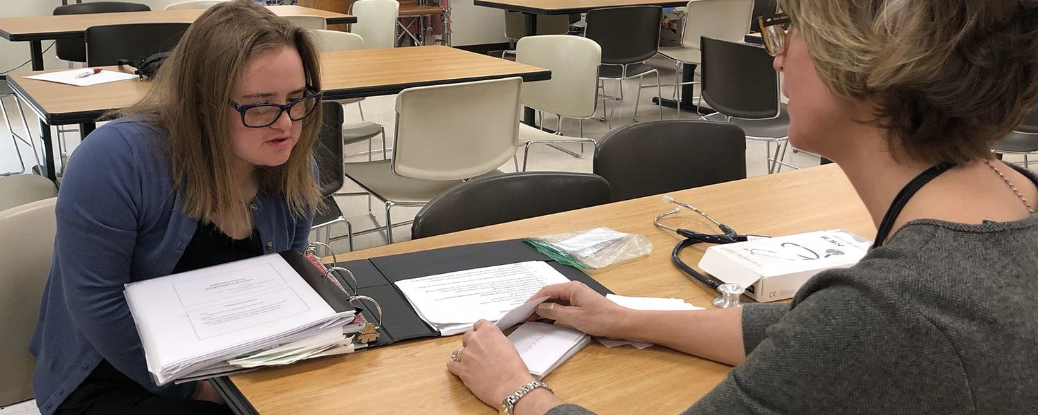 Erin Hawley (left) reviews flash cards with Ann James (right)
