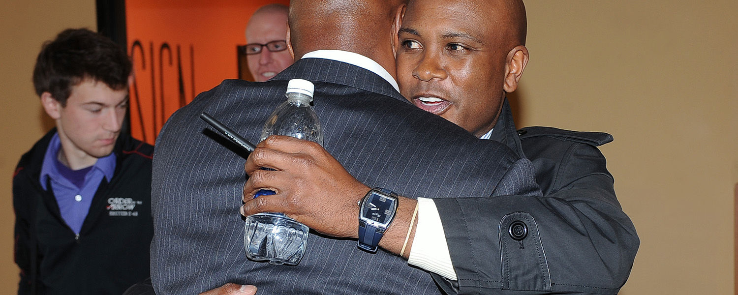 Former Kent State head football coach Darrell Hazell embraces new coach Paul Haynes prior to the press conference in the Governance Chambers in the Kent Student Center.