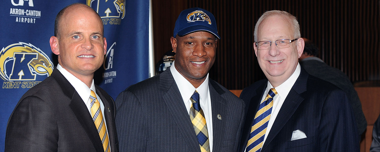 New Kent State head football coach Paul Haynes (center) poses for photos with Kent State Director of Athletics Joel Nielsen (left) and Kent State President Lester A. Lefton (right).