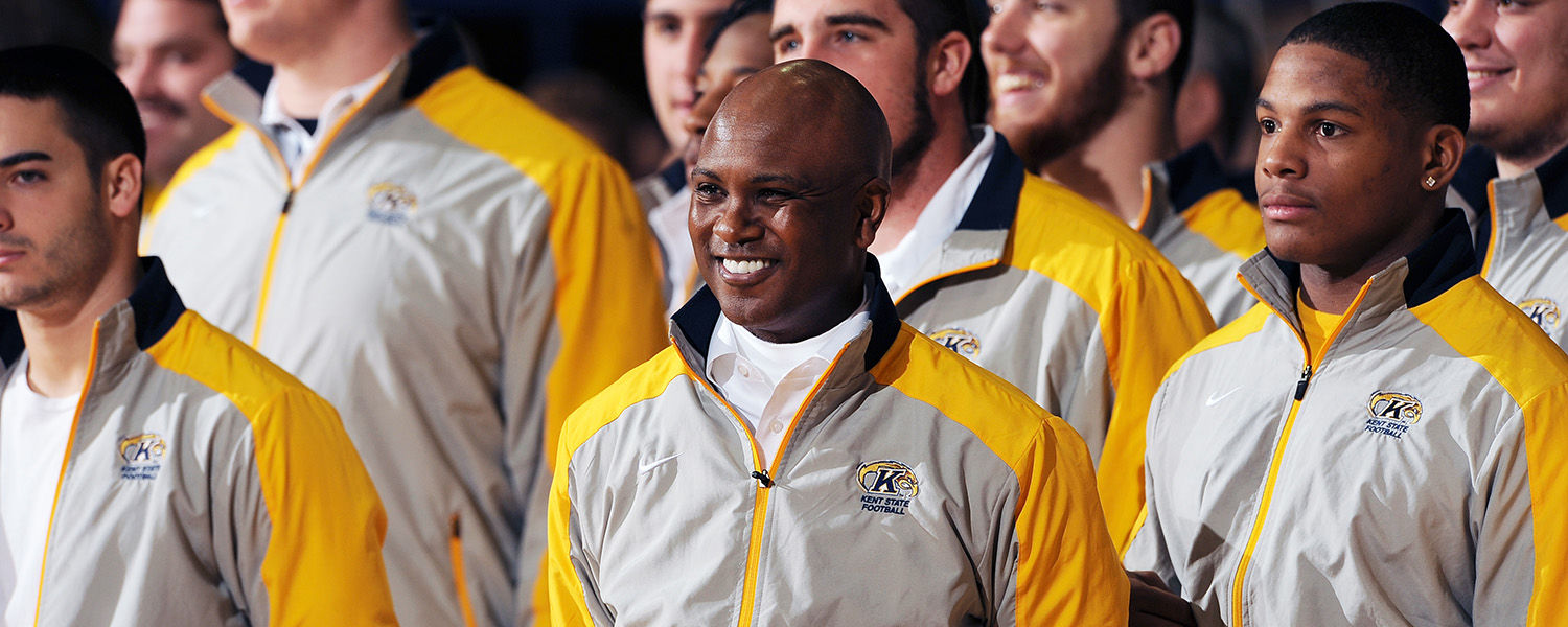 Members of the Kent State football team and Kent State head football coach Darrell Hazell (center) receive applause and cheers from the crowd in attendance at the Mid-American Conference championship send-off event held in the MAC Center.