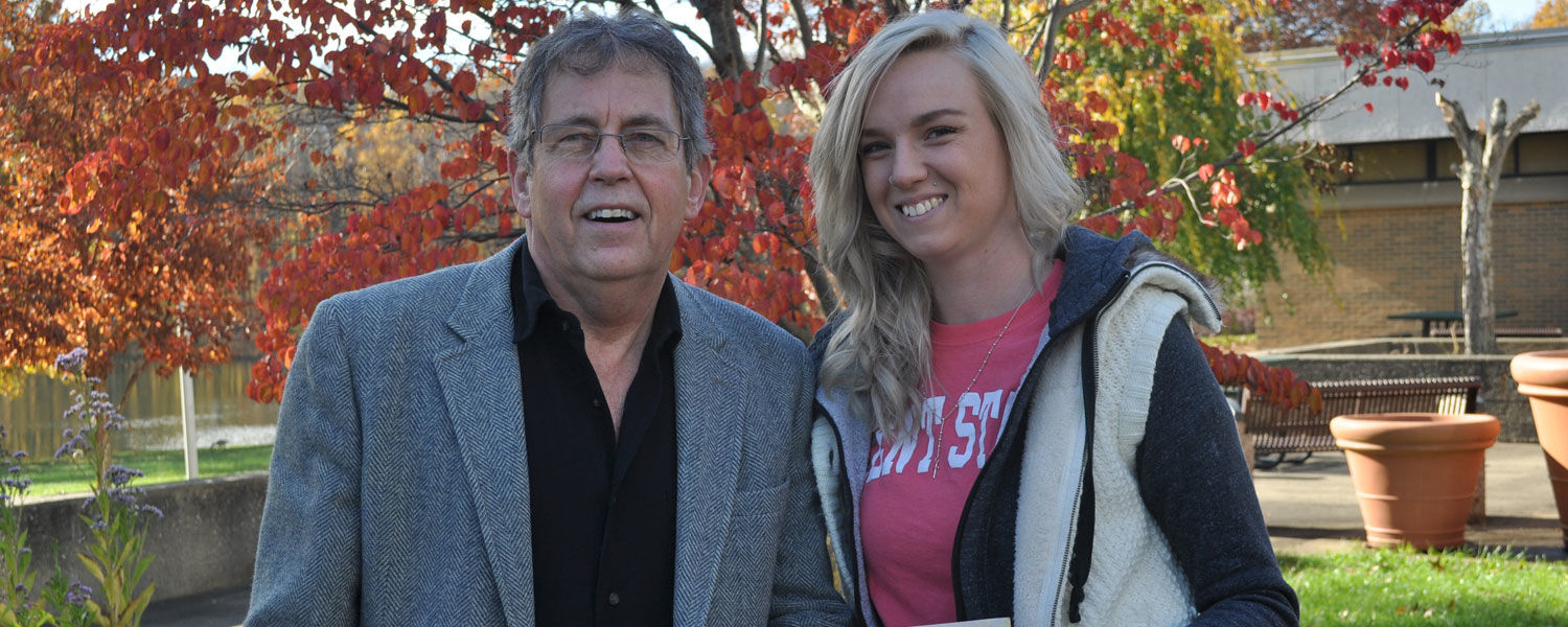 Chris Carlson, associate professor of horticulture technology and biological sciences at Kent State University's Salem Campus, with horticulture student Desiree Pinkerton.
