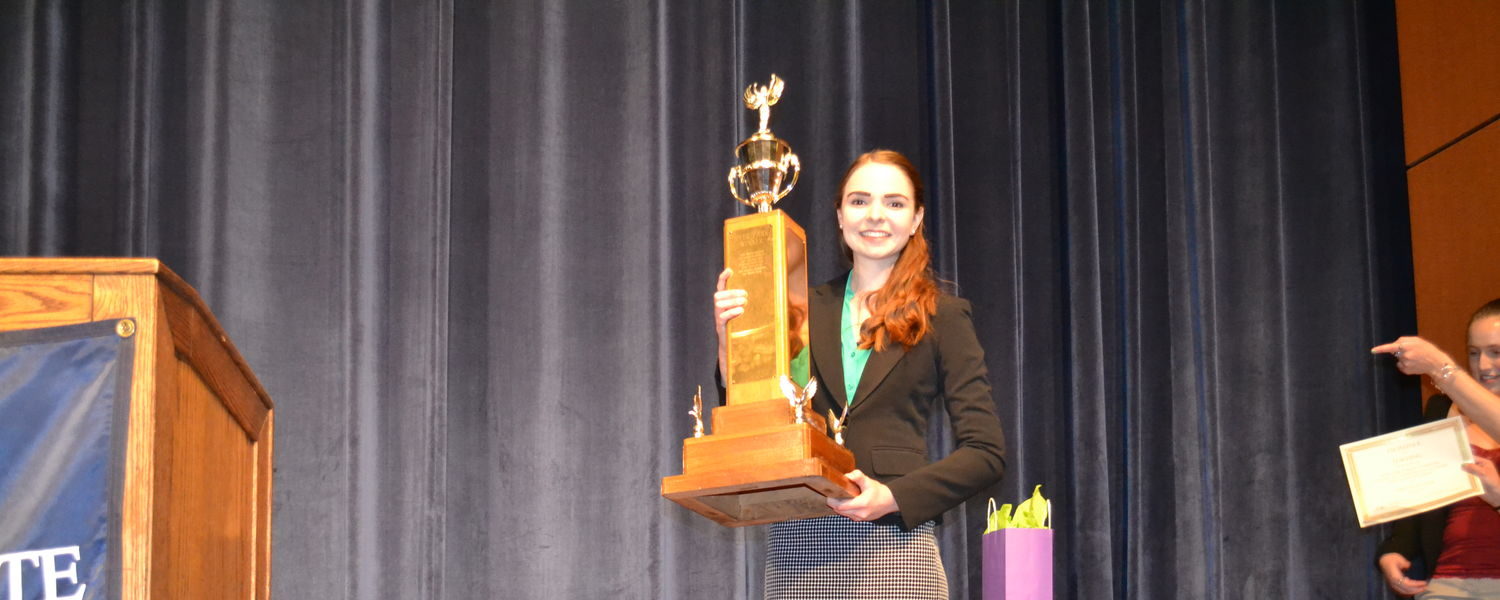 The winner of the Hyde Park Forum poses with her trophy.