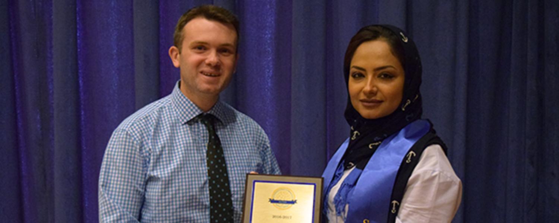 KSU Graduate Student Reema Alosaimi receives the International Community Impact Award from Eron Memaj