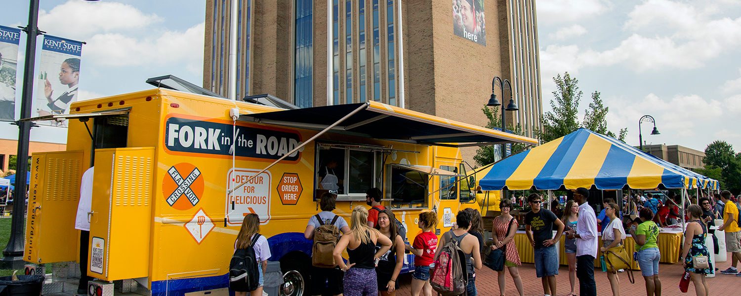 Kent State students line up to try Kent State's food truck, Fork in the Road, which is one of many features at this year's Black Squirrel Festival.
