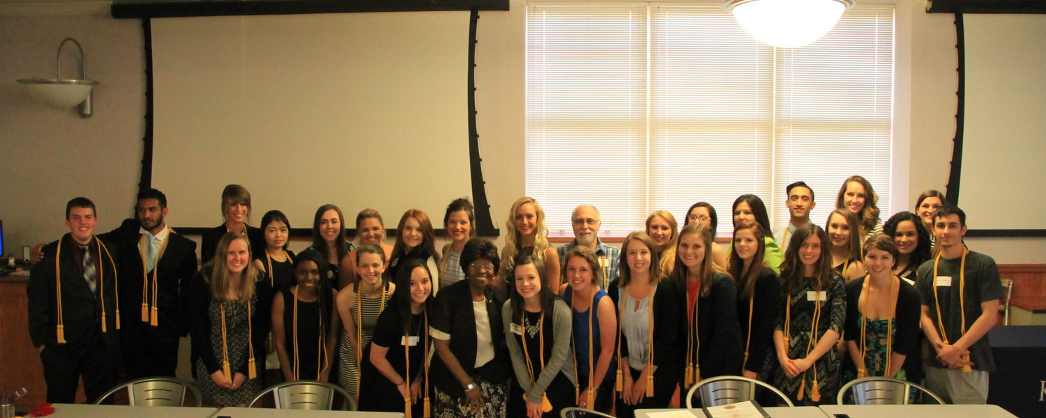 picture of lambda pi eta inductees posing together