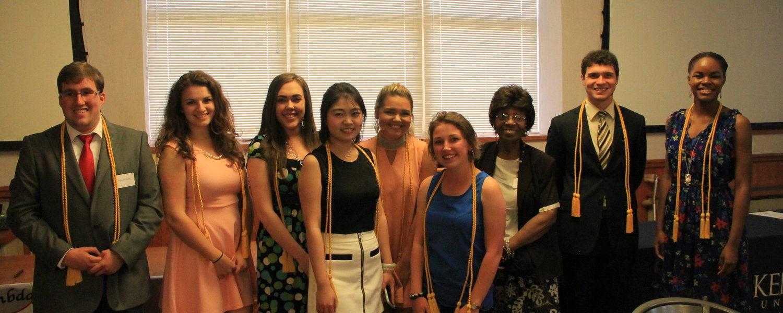 Rozell Duncan poses with members of Lambda Pi Eta and KCS