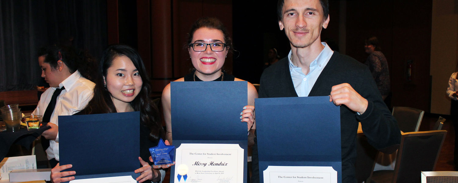 A group of Kent State students proudly displays their leadership certificates and awards at the 37th annual Student Leadership and Honors Awards. (Photo credit: Carrie Circosta, Alumni Relations)
