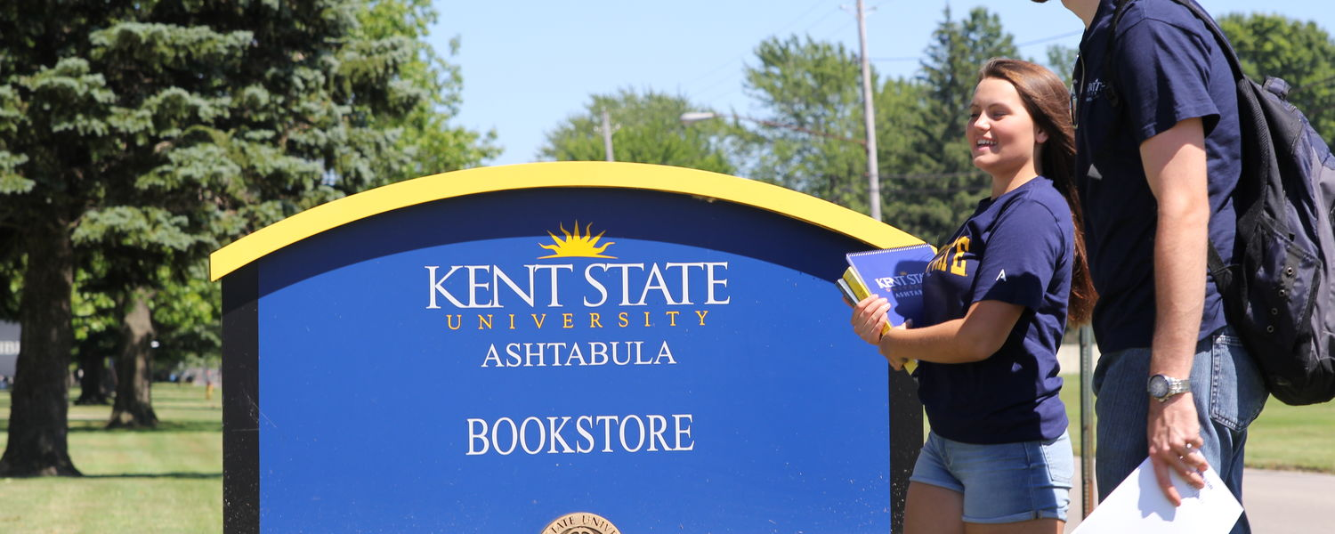 Kent State Ashtabula students walking across campus on a sunny day