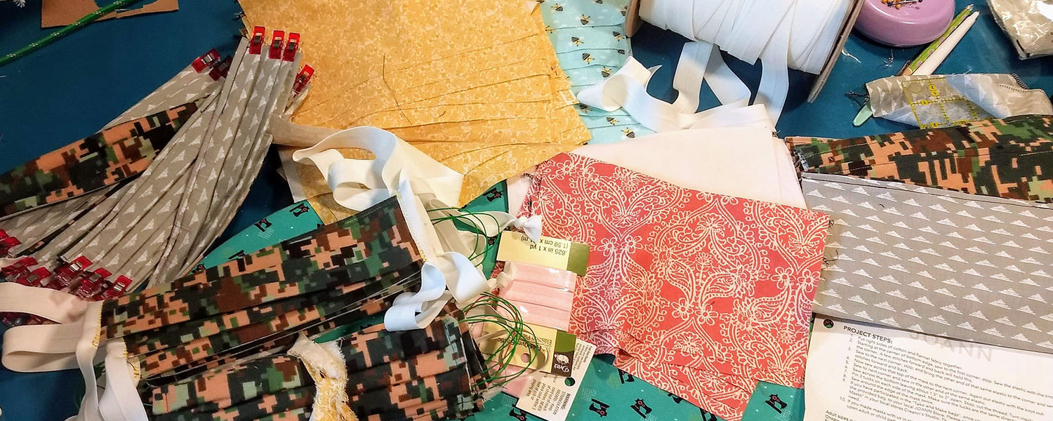 Craft supplies for making masks on craft table