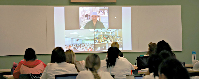 Nursing students watching surgery on livestream