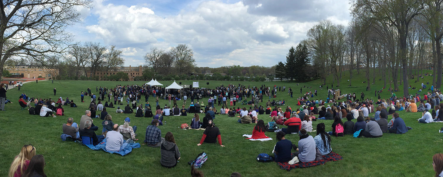 The Kent State Commons and Blanket Hill are covered with people during the 46th observance of May 4, 1970.