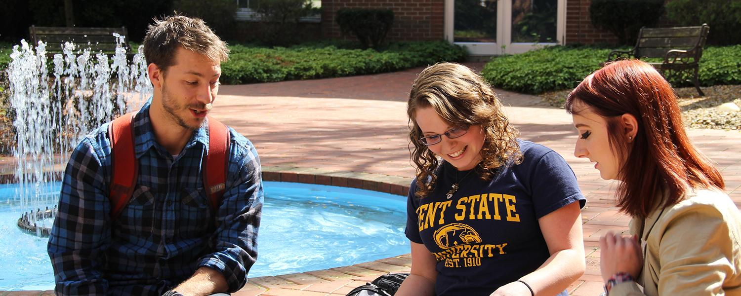 Kent State Ashtabula students study together near the courtyard fountain