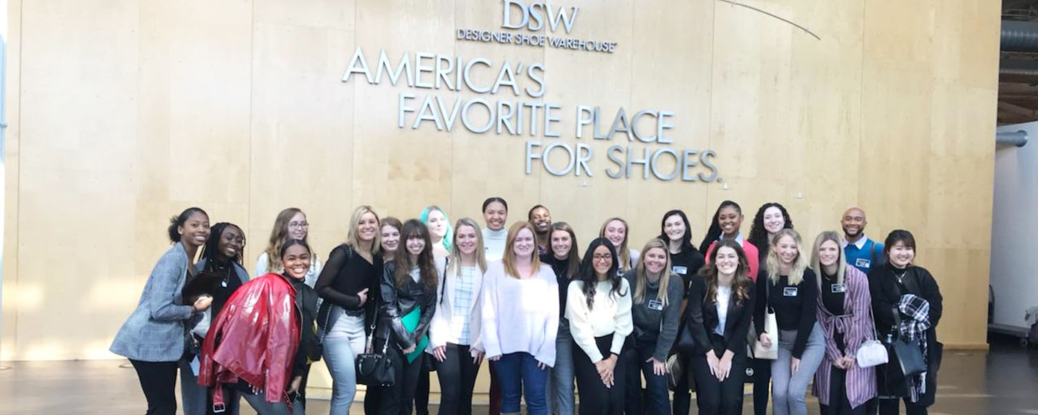 Merchandising students posing at the DSW Headquarters in Columbus, OH.