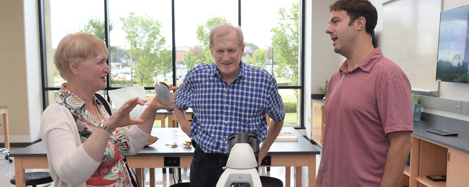 Professors and graduate students welcome visitors to the new laboratory facilities in the Integrated Sciences Building after the grand opening ceremony. Tours included brief introductions to experiments and projects currently underway in the college.