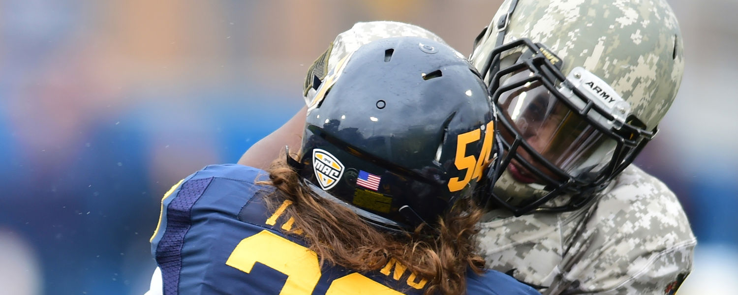 Kent State football player Jordan Italiano faces off with an Army offensive lineman during the 2014 Homecoming victory at Dix Stadium.