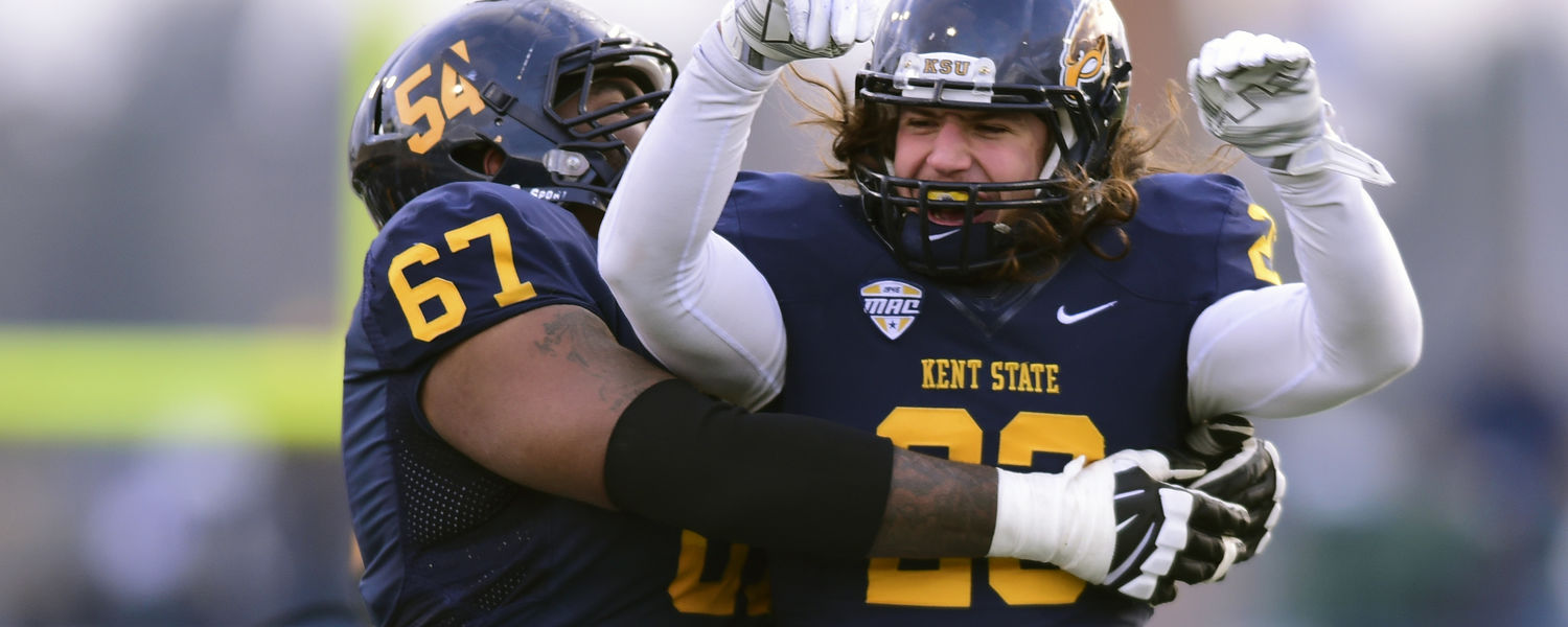 Kent State safety Jordan Italiano celebrates with the defensive line following a critical defensive stand during the 2014 season.