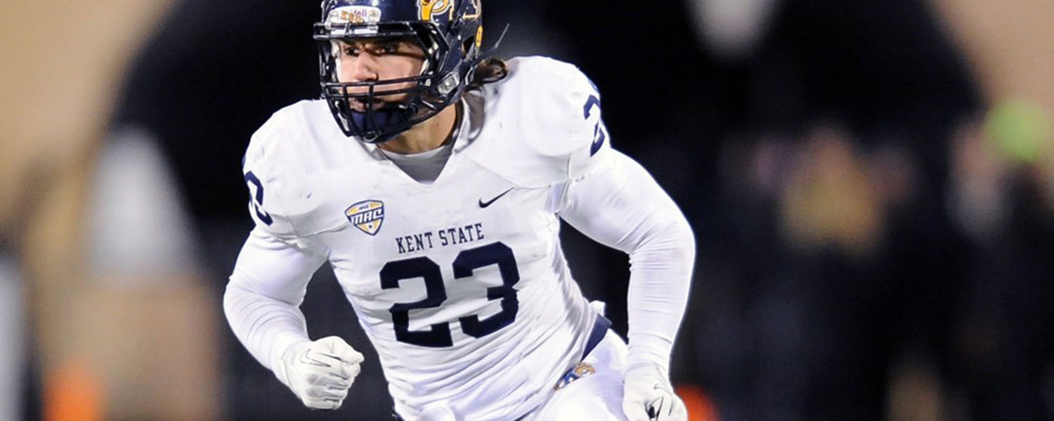 Kent State safety Jordan Italiano moves toward the action after the snap during the 2014 campaign.
