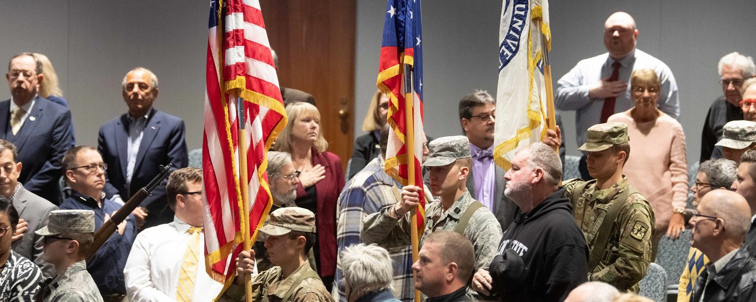 Members of Kent State's Army and Air Force ROTC programs carry the flags in a procession in the Kent Student Center Kiva.