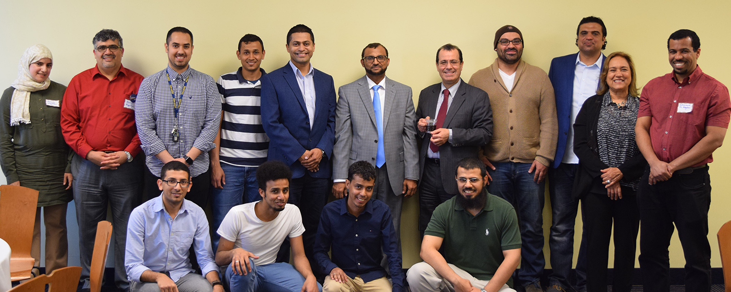 Professor Al-Hazmi (center) posses with students and other guests during the reception following the signing ceremony